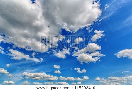 Background of blue sky with cumulus clouds