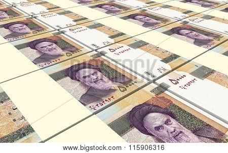 Iranian rials bills stacked background. Computer generated 3D photo rendering.