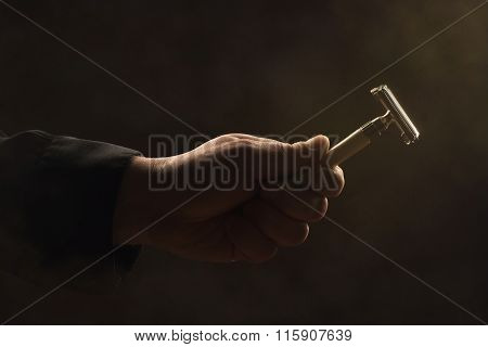 Male Hand Holding Safety Razor