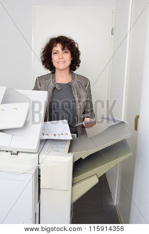 Woman Copying Notes On A Coin Operated Photocopier Isolated