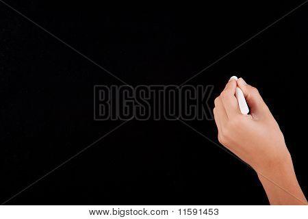 Left Hand Writing On A Blackboard In White