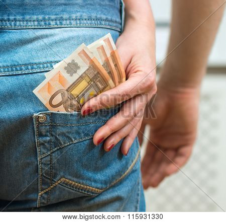 Woman taking money out of man's pocket.