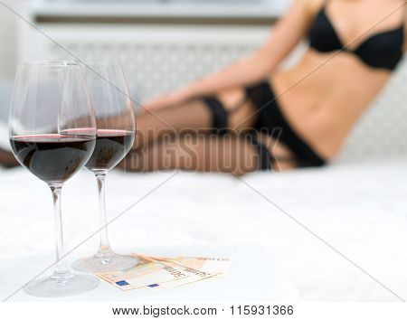 Prostitute is waiting for the client on the bed