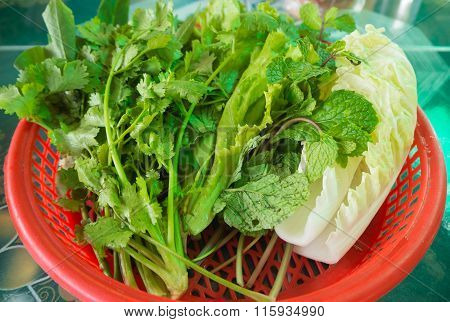 Group Of Vegetable In Red Basket