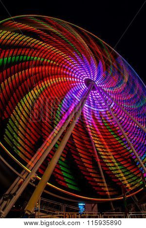 Spiral ferris wheel lights at night