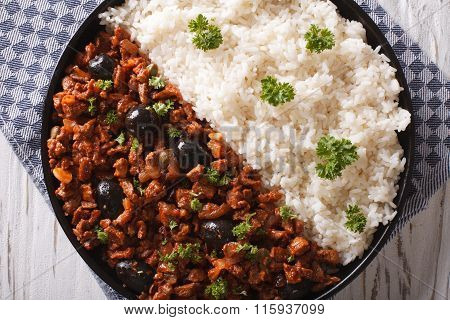 Picadillo A La Habanera With Rice Close-up On The Table. Horizontal Top View