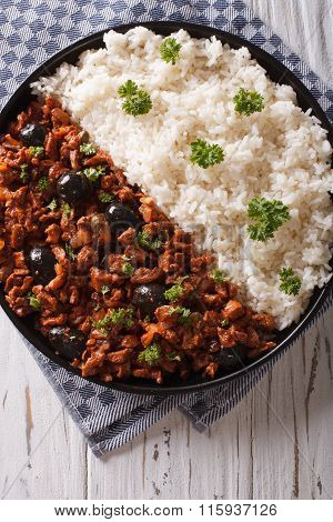 Picadillo A La Habanera With Rice Close-up On The Table. Vertical Top View