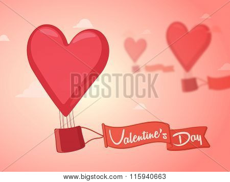 Heart shaped hor air balloon with ribbon flying on glossy cloudy background for Happy Valentine's Day celebration.