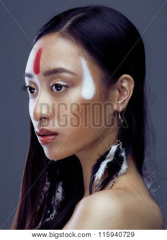 beauty young asian girl with make up like Pocahontas, red indians woman fashion, close up beauty