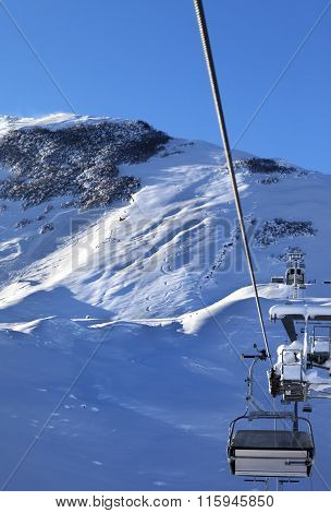 Off-piste Slope And Chair-lift After Snowfall