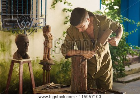Young Sculptor Artist Working And Sculpting Wood Statue-2