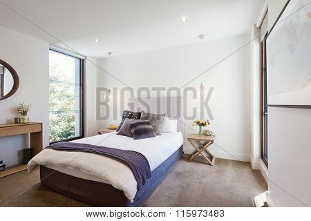 Luxury Interior Designed Bedroom With Comfy Pillows And Throw Rug