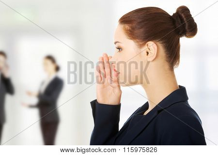 Businesswoman talking gossip