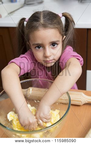 Lovely Little Girl Kneading Dough