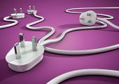 Power plugs lying on bright colored floor unplugged concept for energy and electricity conservation. poster