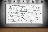 Drawing mathematic formulas on banner in classroom with four lamps poster