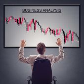 Businessman with trading stock market in economic crisis and line graph showing negative trend decline poster
