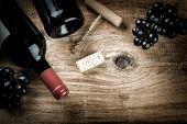 Setting with bottle of red wine grape and corks. Wine list concept with copy space. poster