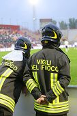 Italian firefighters in the big hardhat during the sports event at the stadium poster