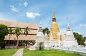 CHIANG MAI, THAILAND - JUNE 6, 2015 - Exterior shot of Wat Suan Dok, Chiang Mai, Thailand. Wat Suan Dok was founded by King Kue Na of Lanna in the 14th century and is a popular Chiang Mai temple. poster
