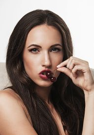 Portrait Of Sexy Woman Holding Cherry