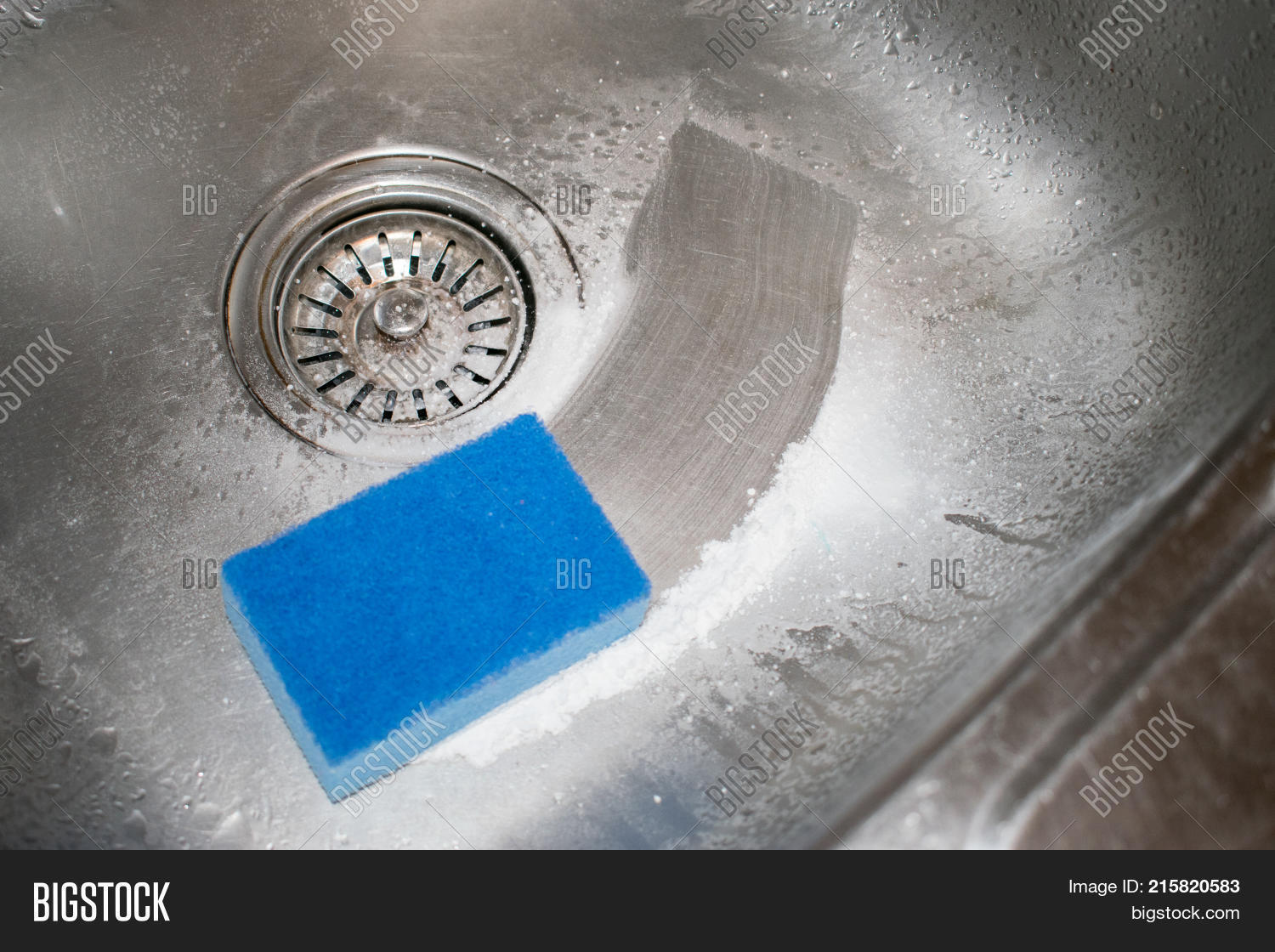 Cleaning Kitchen Sink. How To Clean The Stainless Steel Sink With Cleanser  And Washcloth.