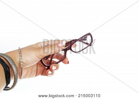 Woman hand holding reading glass on isolated white cutout background. Studio photo with studio lighting easy to use for every concept. White background.