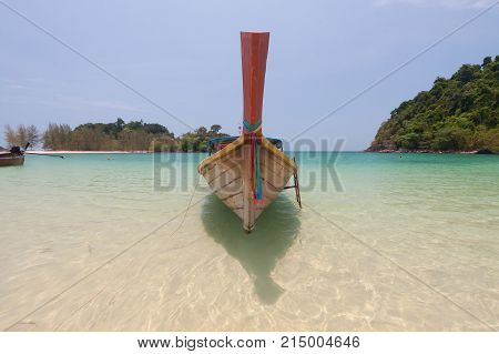 Traditional thai longtail boat on emerald sea at Andaman sea