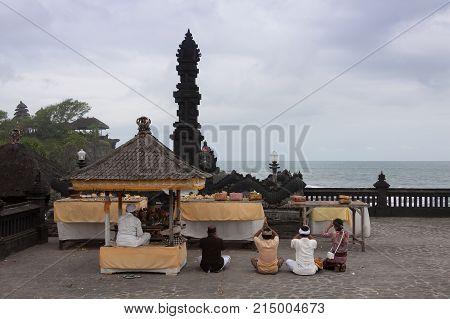 People praying at Tanah lot Bali Indonesia