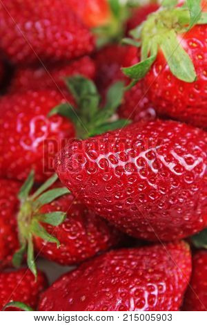 Strawberry strawberries. Stack of fresh red fruit background. Strawberry pattern closeup texture. Whole Strawberries.
