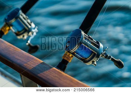 Deep sea fishing charter rod reel gear at sunset