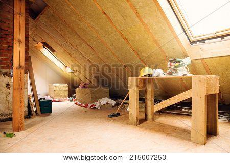 house attic under construction mansard wall insulation