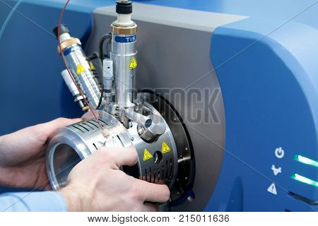 Adjust The Mass Spectrometer. The Man Analyzes The Device For Determining The Masses Of Atoms. Devic