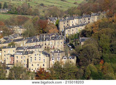 sloping street and tall housed in hebden bridge surrounded by pennine countryside