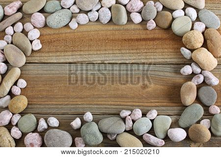 Rocks on Wooden Background with Copy Space