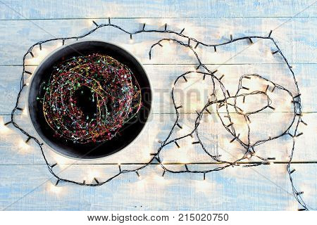 Assorted Fairy Lights on a Wooden Background