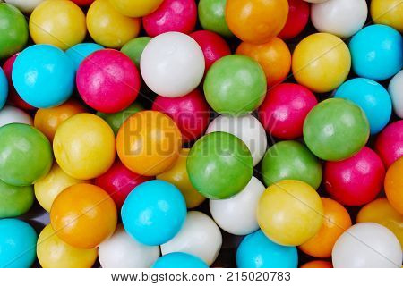 Bubble gum chewing gum texture. Rainbow multicolored gumballs chewing gums as background. Round sugar coated candy dragee bubblegum texture. Food photography. Colorful bubblegums wallpaper. Texture background.