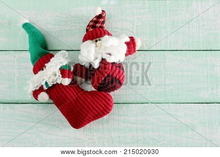 Santa Clause Soft Toys on Wooden Background