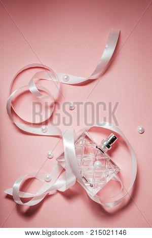 stylish Female perfume on a pink background