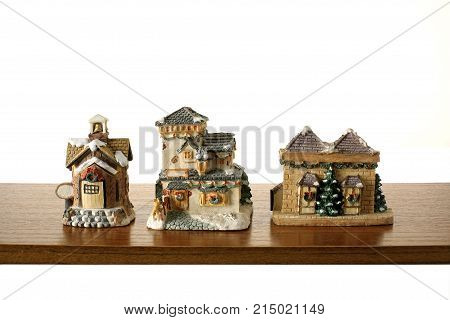 Row of Christmas Decorations on Wooden Shelf