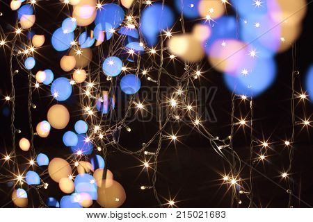 Fairy Lights with Christmas Decorations on Black Background