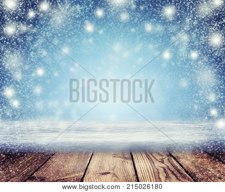 Christmas Holiday Background Christmas table background and blizzard. Christmas night. New Year Frame for your text. Winter nature background.