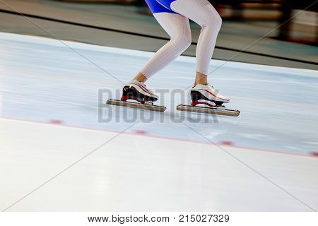 woman legs athlete speed skater in ice rink