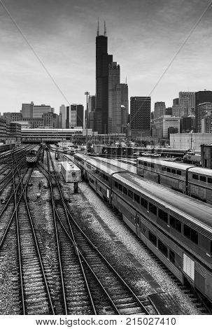 Chicago - March 2017, IL, USA: View of downtown Chicago. Willis Tower, surrounding buildings, railway and Amtrak trains
