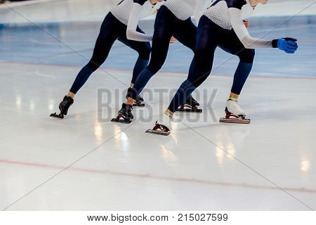 legs group men speed skaters synchronous motion on ice rink