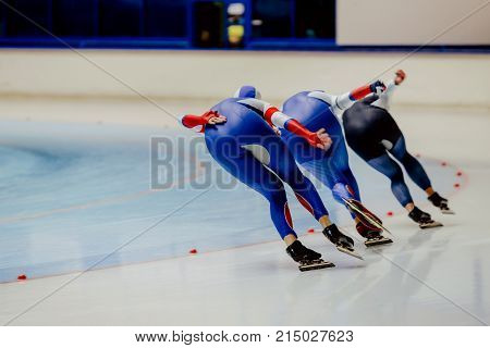 back three women athletes speed skaters in warm up