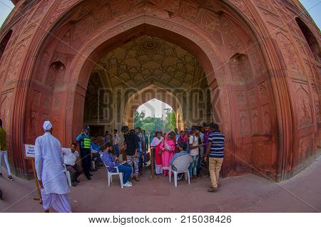 DELHI, INDIA - SEPTEMBER 25 2017: Unidentified tourist walking at the enter of Red Fort in Delhi, India. Fort was the residence of the Mughal emperor for nearly 200 years, built in 1648 by the fifth Mughal Emperor Shah Jahan, fish eye effect.