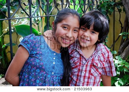 Adorable Hispanic siblings