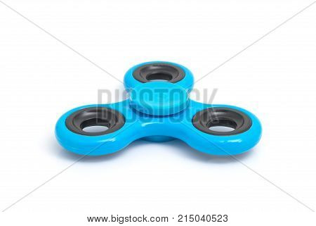 Blue spinner stress relieving toy isolated on white background