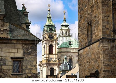 View of Cathedral of Saint Nicolas ( in Mala Strana district) from the Charles Bridge (Karluv Most) in Prague Czech Republic